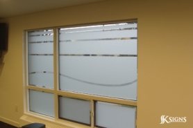 Custom cut etched glass film install in a fitness room