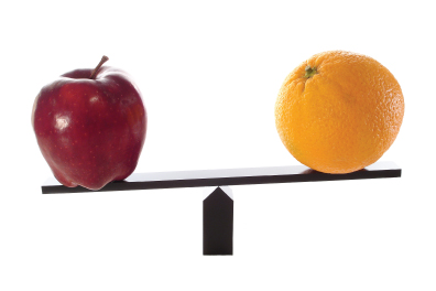 apple and orange on a balance