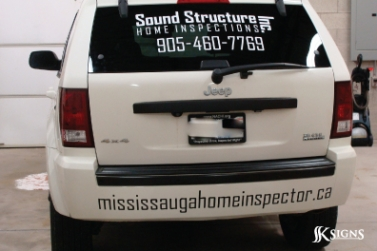 Back of Vehicle with Lettering on Window & Bumper