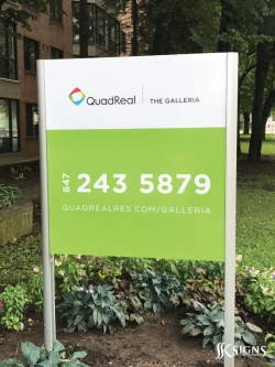 Post and panel signs for QuadReal in Toronto